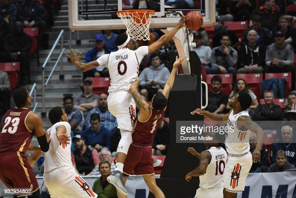 Horace Spencer of the Auburn Tigers blocks a shot by Grant Riller of the Charleston Cougars in the first half in the first round of the 2018 NCAA...
