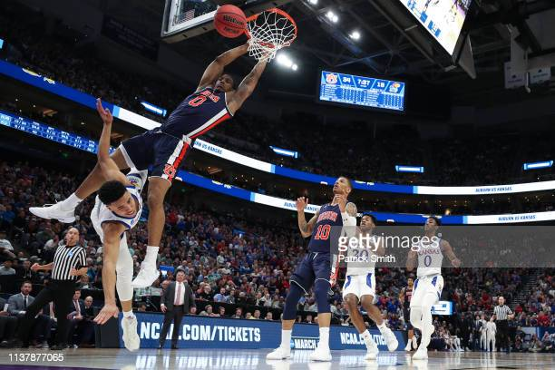 Horace Spencer of the Auburn Tigers defends a shot by Devon Dotson of the Kansas Jayhawks during their game in the Second Round of the NCAA...
