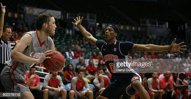 Horace Spencer of the Auburn Tigers defends again the inbound pass of Cullen Neal of the New Mexico Lobos at the Stan Sheriff Center during the...