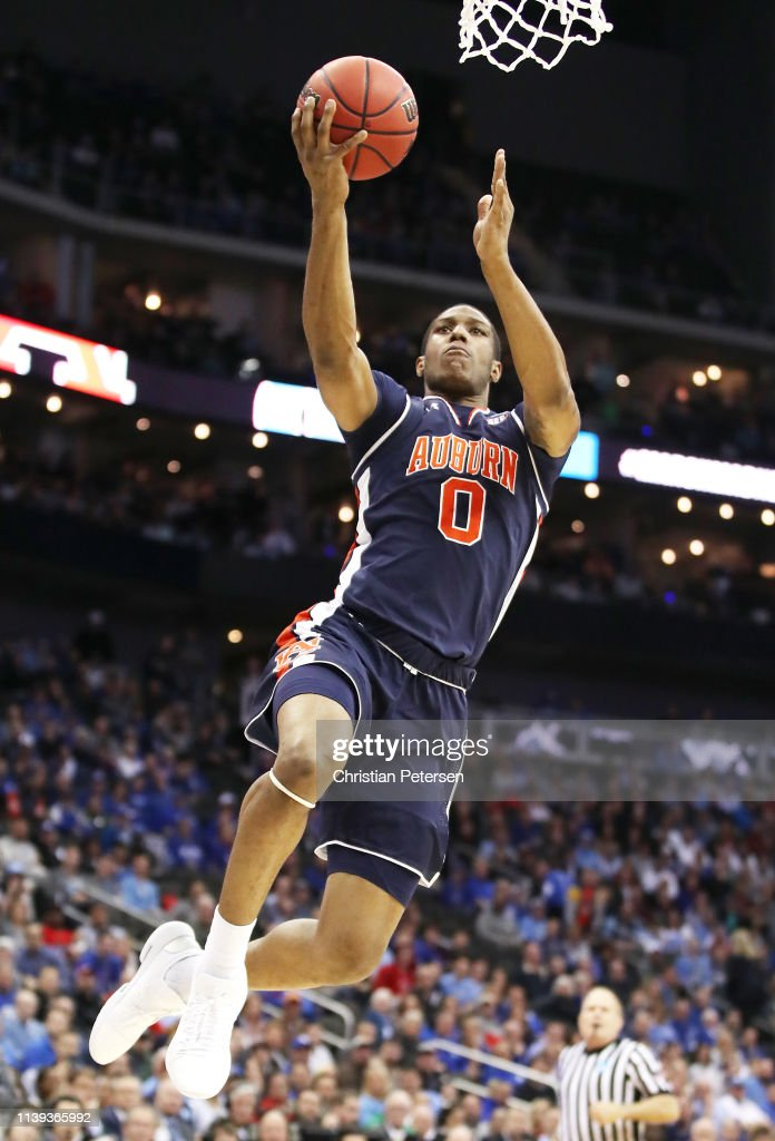 Horace Spencer Of The Auburn Tigers Drives To The Basket