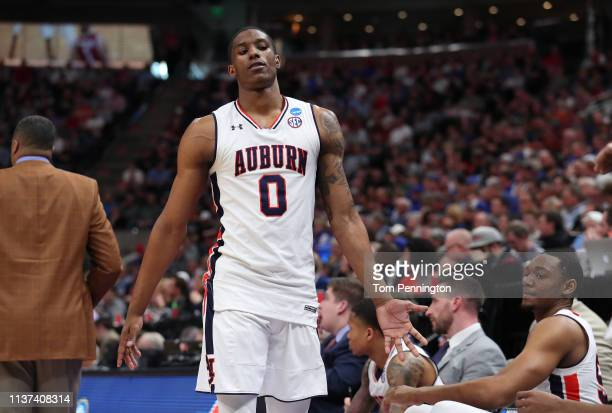 Horace Spencer of the Auburn Tigers high fives teammates during the second half against the New Mexico State Aggies in the first round of the 2019...