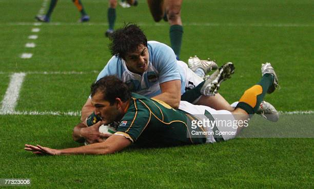 Horacio Agulla of Argentina cannot prevent Fourie du Preez of South Africa from scoring the opening try during the Rugby Word Cup Semi Final between...