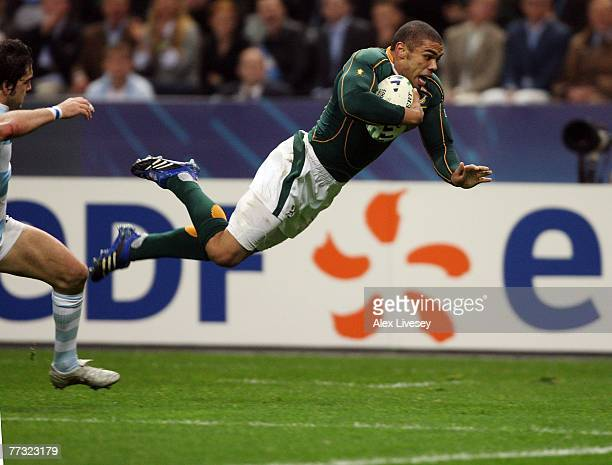 Horacio Agulla of Argentina fails to stop Bryan Habana of South Africa from diving over to score his team's second try during the Rugby Word Cup Semi...