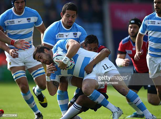Horacio Agulla of Argentina is tackled by Damain Stevens of Namibia during the 2015 Rugby World Cup Pool C match between Argentina and Namibia at...