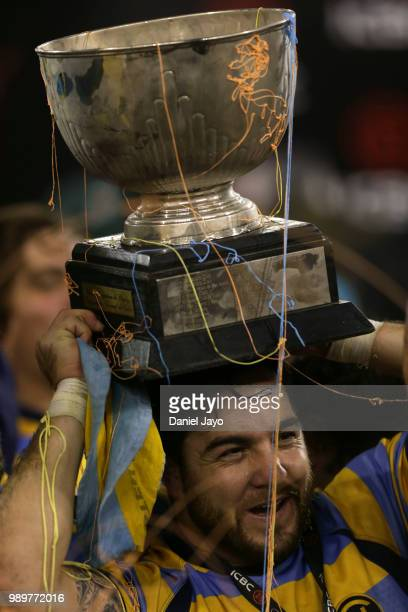 Horacio Agulla of Hindu celebrates with the trophy on his head at the end of the final match between Hindu and Newman as part of Argentina National...