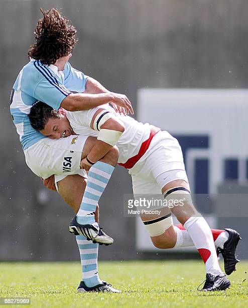 Horacio Alberto San Martin of the Argentina Jaguars gets tackled by Phil Dowson of the England Saxons during the second half of their Churchill Cup...