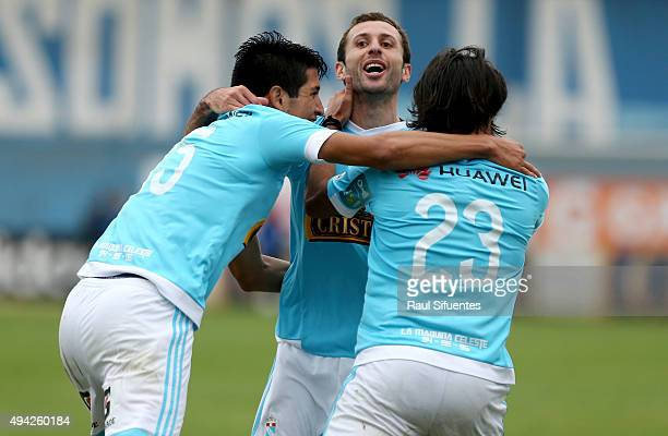 Horacio Calcaterra of Sporting Cristal celebrates with teammates after scoring the second goal of his team against Juan Aurich during a match between...