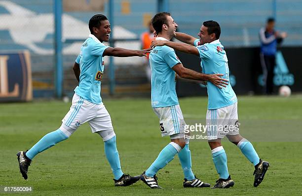 Horacio Calcaterra of Sporting Cristal celebrates with teammates after scoring the fourth goal of his team during a match between Sporting Cristal...