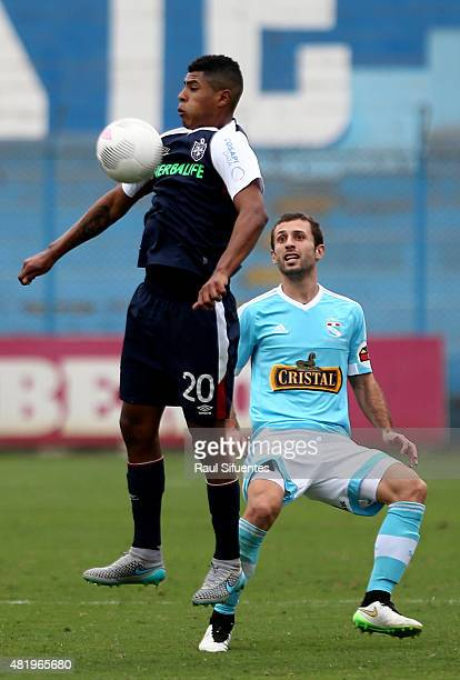 Horacio Calcaterra of Sporting Cristal struggles for the ball with Wilder Cartagena of San Martin during a match between Sporting Cristal and San...