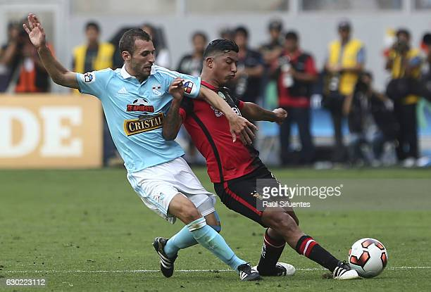 Horacio Calcaterra of Sporting Cristal struggles for the ball with Hernan Hinostroza of FBC Melgar during a second leg final match between Sporting...