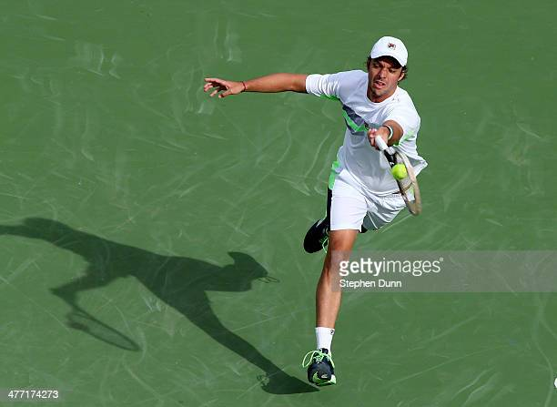 Horacio Ceballos of Argentina hits a return to Rajeev Ram during the BNP Paribas Open at Indian Wells Tennis Garden on March 7 2014 in Indian Wells...