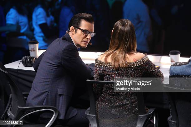 Horacio Villalobos speaks whith Danna Paola during the concert of the reality show La Academia at Azteca Tlalpan on February 9 2020 in Mexico City...