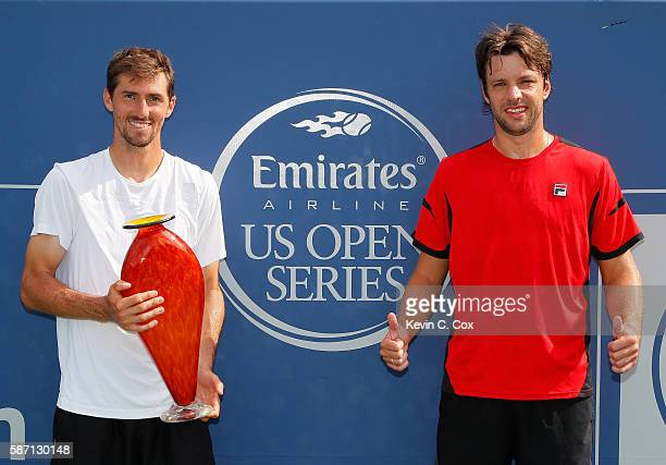 Horacio Zeballos and Andres Molteni of Argentina pose with the trophy after defeating Johan Brunstrom and Andreas Siljestrom of Sweden during the...