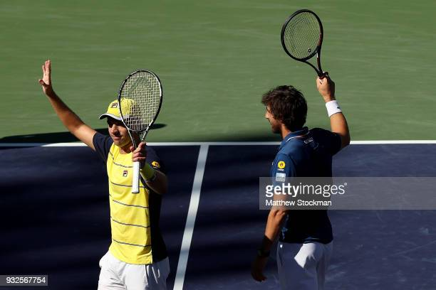 Horacio Zeballos of Argentina and Pablo Cuevas of Uraguay celebrate their win over Gilles Muller of Luxemburg and Sam Querrey during the BNP Paribas...