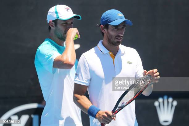 Horacio Zeballos of Argentina and Pablo Cuevas of Uruguay compete in their first round men's doubles match against Jeremy Chardy of France and...