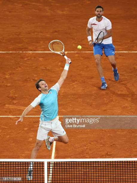 Horacio Zeballos of Argentina plays a forehand shot as Marcel Granollers of Spain looks on during their Mens Doubles Final match against Nikola...