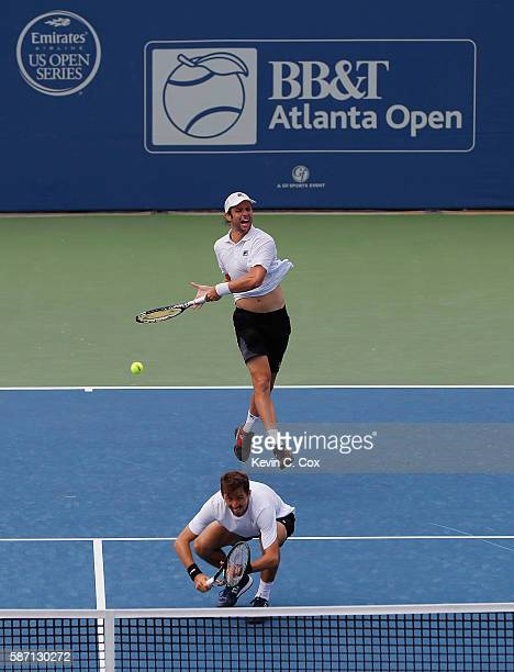 Horacio Zeballos of Argentina returns a forehand to Johan Brunstrom and Andreas Siljestrom of Sweden during the finals of the BBT Atlanta Open at...