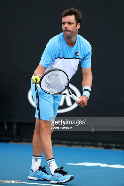 Horacio Zeballos of Argentina serves in his first round doubles match with Lukasz Kubot of Poland against Aljaz Bedene of Slovenia and Maximillian...