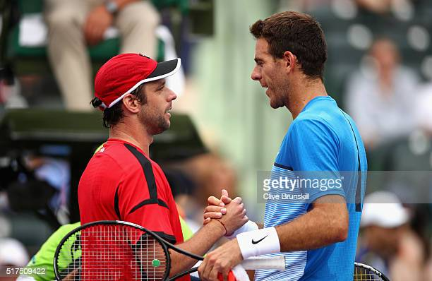 Horacio Zeballos of Argentina shakes hands at the net after his straight sets victory against Juan Martin Del Potro of Argentina in their second...