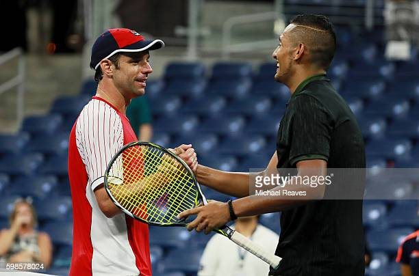 Horacio Zeballos of Argentina shakes hands with Nick Kyrgios of Australia after their second round Men's Singles match on Day Four of the 2016 US...