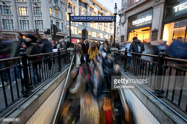 Hordes of Christmas shoppers pour into Oxford Circus tube station on December 14 2013 in London England As Christmas Day approaches London's central...