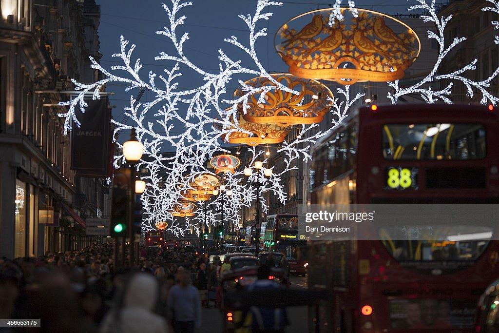 Hordes of Christmas shoppers walk beneath festive lights on Regent Street on December 14, 2013 in London, England. As Christmas Day approaches, London's central shopping districts attempt to lure shoppers into stores with last minute deals in an effort to pull sales away from online outlets.