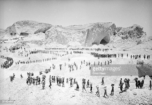 Hordes of extras filming a scene on location in Egypt for the Howard Hawks film 'The Land Of The Pharaohs'