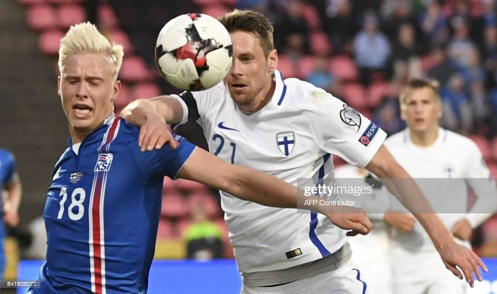 Hordur Magnusson (L) of Iceland and Kasper Hamalainen of Finland vie for the ball during the FIFA World Cup 2018 qualification football match between Finland and Iceland in Tampere on September 2, 2017. / AFP PHOTO / Lehtikuva / Jussi Nukari