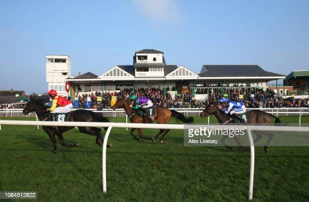 Horese and riders pass the main stand during the Jump Season Starts Now Novices' Hurdle Race at Catterick Racecourse on November 23 2018 in Catterick...