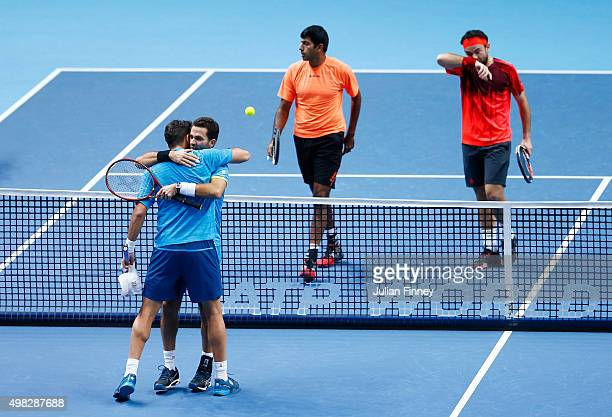 Horia Tecau of Romania and JeanJulien Rojer of France celebrate victory during the men's doubles final against Rohan Bopanna of India and Florin...