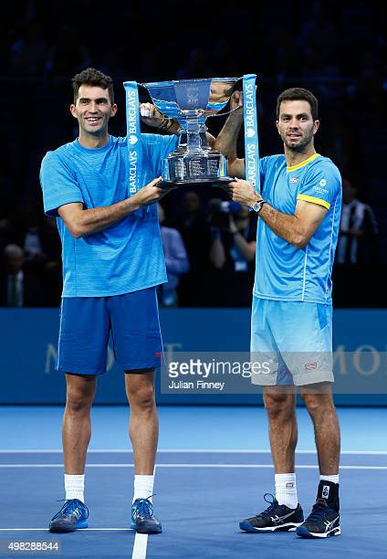 Horia Tecau of Romania and JeanJulien Rojer of France lift the trophy following their victory during the men's doubles final against Rohan Bopanna of...