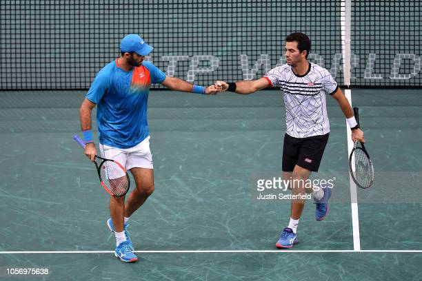 Horia Tecau of Romania and JeanJulien Rojer of of The Netherlands celebrate winning a point during there Semi Final match against Jack Sock of United...