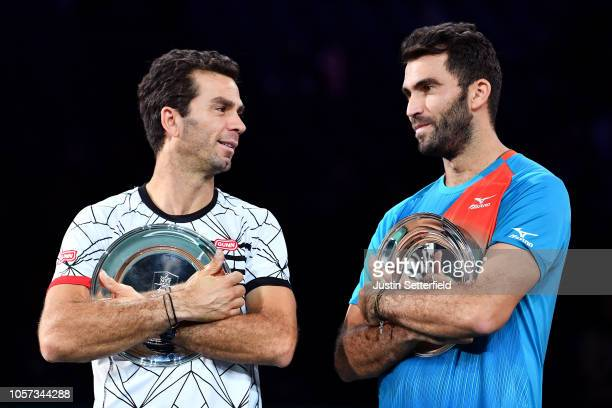 Horia Tecau of Romania and JeanJulien Rojer of of The Netherlands pose with the runners up plates after the Final during Day 7 of the Rolex Paris...