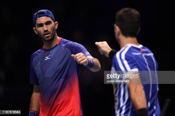 Horia Tecau of Romania and JeanJulien Rojer of The Netherlands celebrate in their doubles match against Nicolas Mahut and PierreHugues Herbert of...