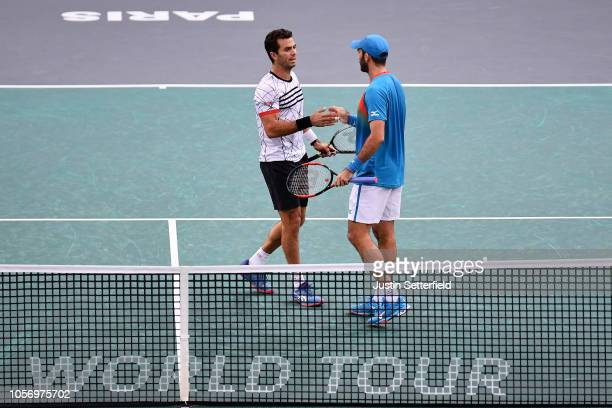 Horia Tecau of Romania and JeanJulien Rojer of The Netherlands celebrate winning match point during there Semi Final match against Jack Sock of...