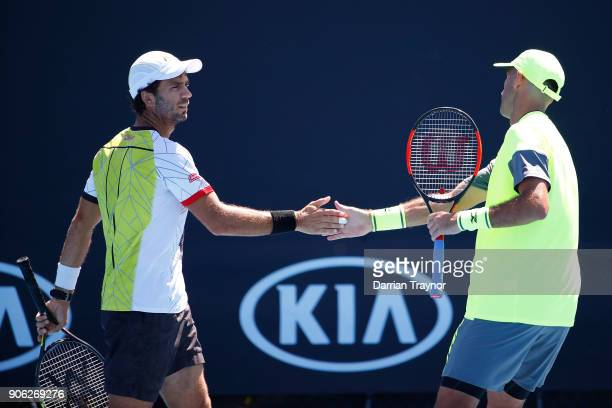 Horia Tecau of Romania and JeanJulien Rojer of the Netherlands talk tactics in their first round men's doubles match against Guillermo Duran of...