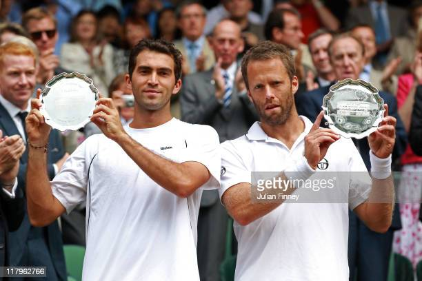 Horia Tecau of Romania and Robert Lindstedt of Sweden hold up their runner-up trophies after losing their final round Gentlemen's Doubles match...