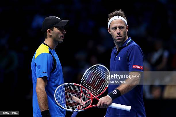 Horia Tecau of Romania and Robert Lindstedt of Sweden talk tactics during the men's doubles match against Mahesh Bhupathi of India and Rohan Bopanna...