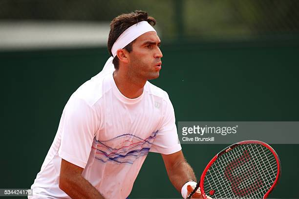 Horia Tecau of Romania awaits a serve during the Men's Doubles first round match against Guido Pella and Horacio Zeballos of Argentina on day five of...
