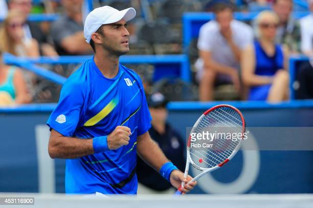 Horia Tecau of Romania celebrates after he and partner JeanJulien Rojer of Netherlands defeated Sam Groth of Australia and Leander Paes of India in...