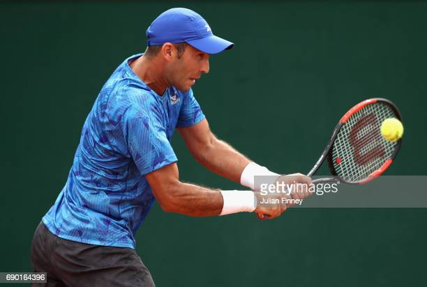 Horia Tecau of Romania partner of JeanJulien Rojer of The Netherlands plays a backhand during the mens doubles first round match against Thomaz...