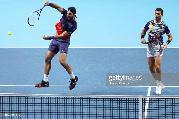 Horia Tecau of Romania playing partner of JeanJulien Rojer of The Netherlands plays a forehand volley in their doubles match against Juan Sebastian...
