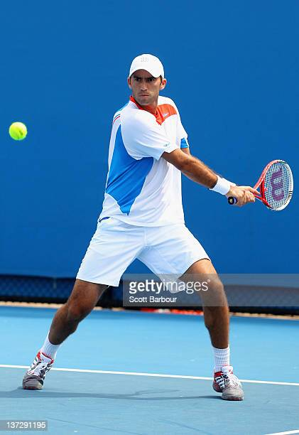 Horia Tecau of Romania plays a backhand in his first round doubles match with Robert Lindstedt of Sweden against Andreas Siljestrom of Sweden and...