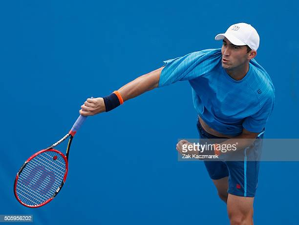 Horia Tecau of Romania serves in his first round doubles match against Martin Klizan of Slovakia and Sergiy Stakhovky of Ukraine during day four of...