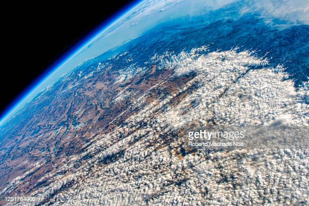 horizon of planet earth, the iss is flying over pakistan and tayikistan - サテライト写真 ストックフォトと画像