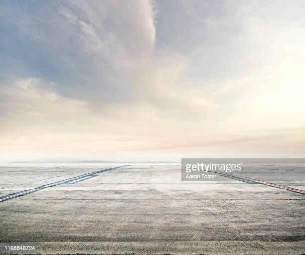 horizon over tarmac lot - airport tarmac stock pictures, royalty-free photos & images
