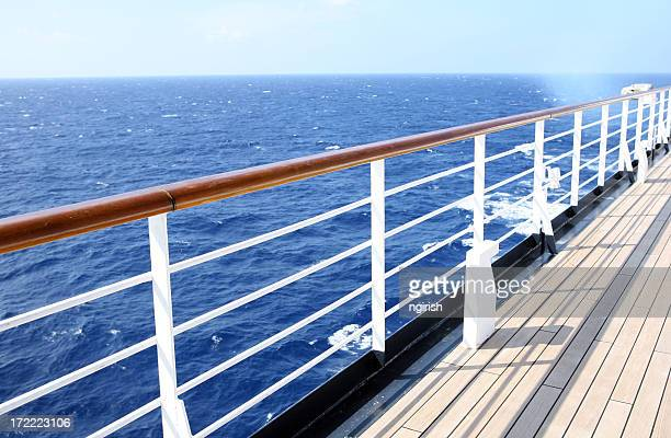 Horizon view from empty cruise ship deck on a sunny day