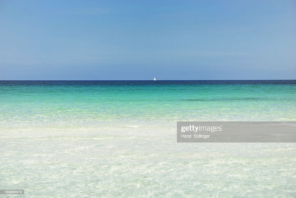 Horizon with sailing ship, turquoise sea with sandy beach, La Cinta, Sardinia, Italy, Europe : Stock Photo