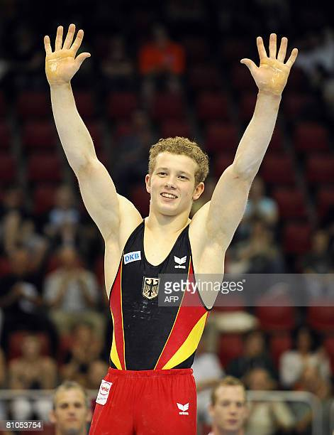 Horizontal bar's world and european champion German Fabian Hambuechen waves to his fans at the end of the 28th European Men's Artistic Gymnastics...
