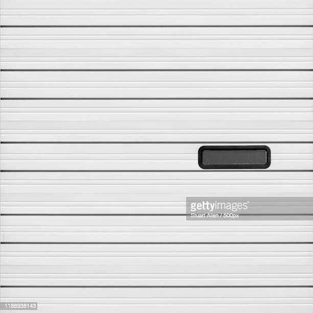 horizontal black stripes on white wall - white stripes stock pictures, royalty-free photos & images